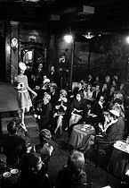 Roger-Viollet   486329    Couturama  at Maxim's (Marie-José Nat and Anna Karina). Paris, 1968. Photograph by Georges Kelaïditès (1932-2015).   © Georges Kelaïditès / Roger-Viollet