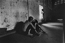 Roger-Viollet | 497529 |  The mental home . Patients confined in a mental hospital. Saigon (Vietnam), 1975. | © Françoise Demulder / Roger-Viollet