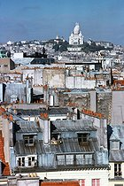 Roger-Viollet | 499074 | View of Parisian roofs and the Sacré-Coeur basilica from the rue Réaumur. Paris (IInd arrondissement), November 1976. Photograph by Léon Claude Vénézia (1941-2013). | © Léon Claude Vénézia / Roger-Viollet