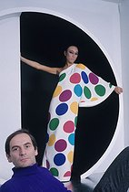 Roger-Viollet   507400   Pierre Cardin (born in 1992), French fashion designer, with a model wearing one of his dresses. France, around 1970.   © Jean-Régis Roustan / Roger-Viollet