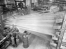 Roger-Viollet | 513494 | Weaving loom of a mill. France, around 1930. | © Laure Albin Guillot / Roger-Viollet