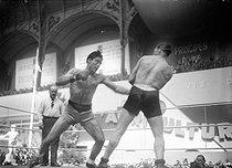 Roger-Viollet | 513569 | Boxing match. Marcel Cerdan versus Viez. Paris, Grand Palais, May 1942. | © LAPI / Roger-Viollet