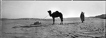 Roger-Viollet | 521123 | Prayer in the desert. South Algeria. | © Léon & Lévy / Roger-Viollet