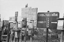 Roger-Viollet | 524562 | Mailboxes in a shanty town. Saint-Denis (France). 1967. | © Georges Azenstarck / Roger-Viollet