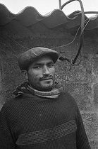 Roger-Viollet | 527571 | Man from a Portuguese community living in a shanty town. Champigny-sur-Marne (France), 1967. | © Georges Azenstarck / Roger-Viollet