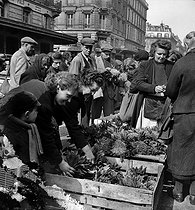 Roger-Viollet | 532774 | Selling lily of the valley at the central Halles market. Paris, April 29, 1944. | © LAPI / Roger-Viollet