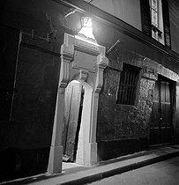 Roger-Viollet | 542032 | Old door of a brothel, rue de la Lune. Paris (Xth arrondissement, 1939. | © Pierre Jahan / Roger-Viollet