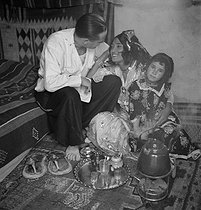 Roger-Viollet | 544030 | A prostitute and her daughter. North Africa, circa 1945. | © Gaston Paris / Roger-Viollet