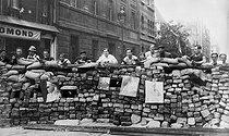 Roger-Viollet | 544373 | World War II. Liberation of Paris. Barricade kept by resistance fighters from the FFI (French Forces of the Interior) with portraits of Goëring, Himmler and Hitler hanging. Paris, August 24, 1944. | © LAPI / Roger-Viollet