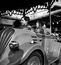 Roger-Viollet | 546992 | Carousel at the Foire du Trône fun fair. Paris (XIIth arrondissement), 1940's. | © LAPI / Roger-Viollet