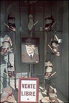 Roger-Viollet | 552961 | World War II. Portrait of the Marshal Pétain in the window of a shoe shop, avenue de l'Opéra. Paris, avril 1942. Photograph by André Zucca (1897-1973). Bibliothèque historique de la Ville de Paris.$$$$$$ | © André Zucca / BHVP / Roger-Viollet