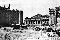 Roger-Viollet | 569744 | Clearing the space before the Opéra de Paris. Demolition of the Butte des Moulins which stretched to the Louvre, during the works led by the baron Georges Eugène Haussmann in 1867. | © Roger-Viollet / Roger-Viollet