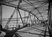 Roger-Viollet   569900   Renault manufacture. Workers on the footbridge of the Ile Seguin. Boulogne-Billancourt (Hauts-de-Seine), 1954. Photograph by René Giton (known as René-Jacques, 1908-2003). Bibliothèque historique de la Ville de Paris.   © René-Jacques / BHVP / Roger-Viollet