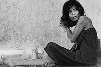 Roger-Viollet | 608698 |  Is it insanity or fear in her eyes ? . Patient confined in a mental hospital. Saigon (Vietnam), 1975. | © Françoise Demulder / Roger-Viollet