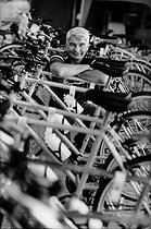 Roger-Viollet | 612402 | Raymond Poulidor (1936-2019), French racing cyclist, selling  Poulidor  bicycles in a Leclerc hypermarket. France, 1998. | © Jean-Pierre Couderc / Roger-Viollet