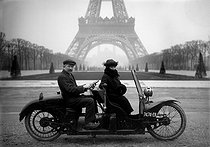 Roger-Viollet | 613806 | Two-seater motorcycle at the Champ-de-Mars. Paris, 1922. | © Jacques Boyer / Roger-Viollet
