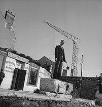 Roger-Viollet | 625705 | Display mannequin in front of a tailor's shop. Orléans (France), 1947. | © Pierre Jahan / Roger-Viollet