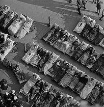 Roger-Viollet   634595   Pilgrimage to Lourdes. Pilgrims and sick people on the square of Notre-Dame-du-Rosaire basilica. Lourdes (France), June-July 1939. Photograph by Pierre Jahan (1909-2003).   © Pierre Jahan / Roger-Viollet