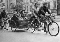 Roger-Viollet | 637387 | World War II. Cycle taxi in Paris, under the Occupation. | © Albert Harlingue / Roger-Viollet