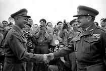 Roger-Viollet | 640614 | Second Arab-Israeli conflict. Moshe Dayan, Israeli commander-in-chief, and Burns, Canadian General, representative of the UNO after the ceasefire. Israel, on December 7, 1956. | © Bernard Lipnitzki / Roger-Viollet
