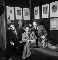 Roger-Viollet   647632   Jean Cocteau, French writer, with Serge Reggiani and Jean Marais, in his flat at the Palais-Royal. Paris, September 1941.   © Pierre Jahan / Roger-Viollet