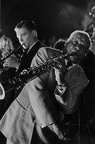 Roger-Viollet | 650854 | Sidney Bechet (1897-1959), American jazz musician, performing at the Arènes de Lutèce. Paris (Vth arrondissement), 1953. Photograph by Jean Marquis (1926-2019). | © Jean Marquis / Roger-Viollet
