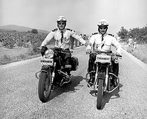 Roger-Viollet   652643   Motorcyclists of the national police force escorting the Tour de France (on 1966 or 1967).   © Roger-Viollet / Roger-Viollet