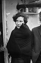 Roger-Viollet | 657222 | Young woman of the Portuguese community in a shanty town. La Courneuve (Seine-Saint-Denis), 1967. | © Georges Azenstarck / Roger-Viollet