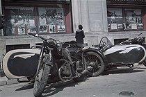 Roger-Viollet | 662814 | World War II. Motorbikes in front of  Paris-Soir . Paris, 1943. Photograph by André Zucca (1897-1973). Bibliothèque historique de la Ville de Paris. | © André Zucca / BHVP / Roger-Viollet