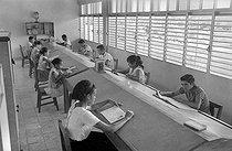Roger-Viollet | 676683 | Library. Yaguajay (Cuba), around 1960. | © Gilberto Ante / Roger-Viollet