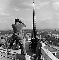 Roger-Viollet | 680161 | View from the top of the Notre-Dame de Paris Cathedral. Paris, 1950's. Photograph by Janine Niepce (1921-2007). | © Janine Niepce / Roger-Viollet