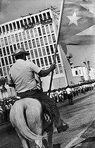 Roger-Viollet | 690058 | Man on horseback taking part in a popular gathering for Revolution. Cuba, 1962. | © Gilberto Ante / BFC / Roger-Viollet