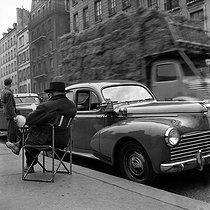 Roger-Viollet | 693329 | Peugeot 203 taxi stopped at a taxi rank. Paris, quai Saint-Michel, 1954. | © Roger-Viollet / Roger-Viollet