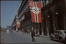 Roger-Viollet | 694031 | World War II. Swastikas on the rue de Rivoli, towards the Concorde, Paris. Photograph by André Zucca (1897-1973). Bibliothèque historique de la Ville de Paris. | © André Zucca / BHVP / Roger-Viollet