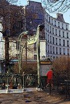 Roger-Viollet | 700045 | Woman going out from the Ménilmontant metro station. Paris (XXth arrondissement), February 1970. Photograph by Léon Claude Vénézia (1941-2013). | © Léon Claude Vénézia / Roger-Viollet