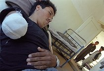 Roger-Viollet   705203   Second war in Afghanistan between the USA and the Northern Alliance against the Taliban following the September 11, 2001 attacks. 20-year-old Mujahid wounded on the Northern Alliance front and treated at the hospital of Khwadja Bahauddin, city where the Commander Ahmad Shah Massoud has been killed. Afghanistan, September-October 2001.   © Jean-Paul Guilloteau / Roger-Viollet