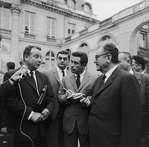 Roger-Viollet | 713629 | Events of May-June 1968. Accords de Grenelle (Grenelle Agreements). Georges Séguy (representative of the CGT, Confédération Générale du travail, General Confederation of Labour) and Benoît Frachon (general secretary of the CGT) answering the journalists in the courtyard of the Ministry of Labour. Paris, on May 26, 1968. Photograph by Georges Azenstarck (born in 1934). | © Georges Azenstarck / Roger-Viollet