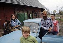 Roger-Viollet | 714997 | Family of East German refugees at the Burg village, in front of a Wartburg. West Germany, 1989. | © Jean-Paul Guilloteau / Roger-Viollet