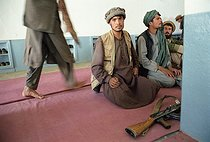 Roger-Viollet   721412   Second war in Afghanistan between the USA and the Northern Alliance against the Taliban following the September 11, 2001 attacks. Mujahideen and their Kalachnikov during the Friday prayer at the mosque of Jabal-Saraj. Afghanistan, September-October 2001.   © Jean-Paul Guilloteau / Roger-Viollet