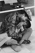Roger-Viollet | 723140 | Vietnam War. Wounded child at the hospital with his father, he died a few days later. Saigon, 1975. The original caption said: 3/4, the death of a child.  Despair remains . | © Françoise Demulder / Roger-Viollet