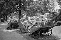 Roger-Viollet | 731620 | Wooden horses on a handcart. France, circa 1935. | © Gaston Paris / Roger-Viollet