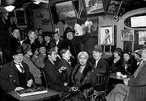 Roger-Viollet | 735915 | Inside of a café at Montparnasse. Center: the model Aïcha  la Noire . Paris, around 1930. | © Albert Harlingue / Roger-Viollet