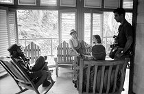 Roger-Viollet | 750389 | Fidel Castro (1926-2016), Cuban revolutionary and statesman, with a family. Santiago de Cuba (Cuba), circa 1960. | © Gilberto Ante / Roger-Viollet