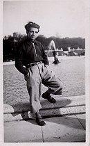 Roger-Viollet | 754045 | Missak Manouchian (1906-1944), Armenian poet and resistance fighter, posing near the pond of the Tuileries Garden. Paris (Ist arrondissement). | © Archives Manouchian / Roger-Viollet