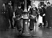 Roger-Viollet | 754473 | Wastepaper baskets in a street of Paris. 1907. | © Jacques Boyer / Roger-Viollet
