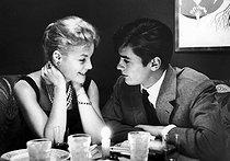 Roger-Viollet | 785247 | Romy Schneider (1938-1982), Austrian actress, and Alain Delon (born in 1935), French actor. Paris, on October 9, 1958. | © Bernard Lipnitzki / Roger-Viollet