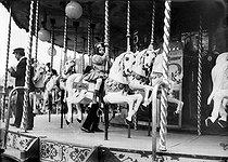 Roger-Viollet | 804187 | Child on a roudabout. Paris, Fête des Invalides, 1908. | © Jacques Boyer / Roger-Viollet