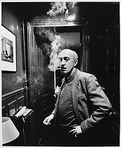 Roger-Viollet | 816287 | Otar Iosseliani (born in 1934), Georgian director, at home. Paris, January 1990. | © Bruno de Monès / Roger-Viollet