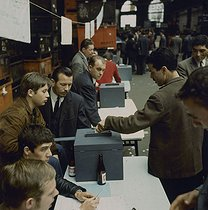 Roger-Viollet | 818334 | May-June 1968 events. Workers from the Citroën car factory voting for the renewal of the strike. Paris, May 1968. Photograph by Georges Azenstarck (born in 1934). | © Georges Azenstarck / Roger-Viollet