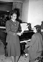Roger-Viollet   829202   Josephine Baker (1906-1975), American variety artist, reahearsing with Vincent Sotto, dressed in a uniform of a French Air Force Lieutenant (Forces françaises Libres, FFL, Free French Forces). Paris, October 1944.   © LAPI / Roger-Viollet